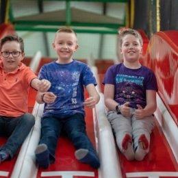 boys sliding indoor play